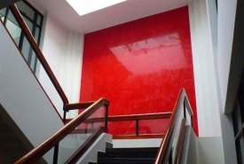 ultraconcentrated red venetian plaster applied in six coats and waxed and polished twice