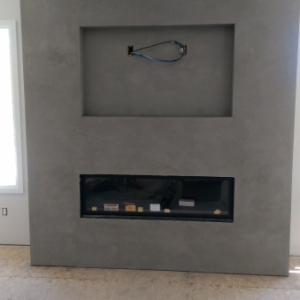 Meoded Golmex plaster used to create a polished concrete look on this new fireplace