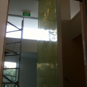 Green wall in yoga studio for entrance, two coats of polished venetian plaster and a wax